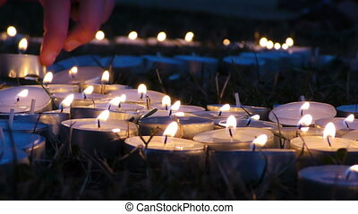 Candles on Grass at Night