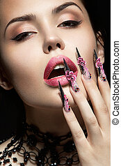 Beautiful girl with long nails