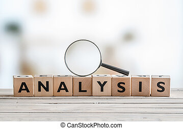Analysis with a magnifying glass on wooden cubes