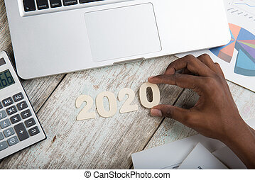 Hand arranging financial year 2020