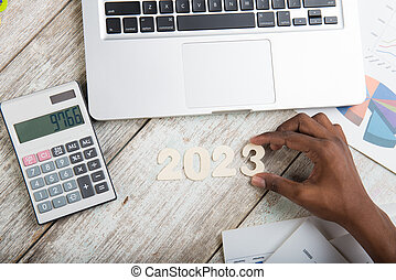Hand arranging financial year 2023