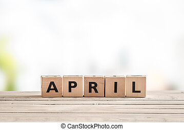 April sign with wooden cubes