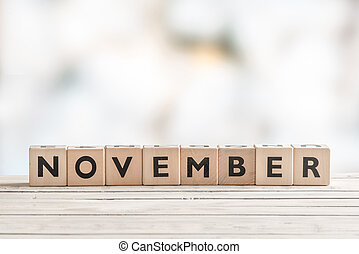 November sign with wooden blocks