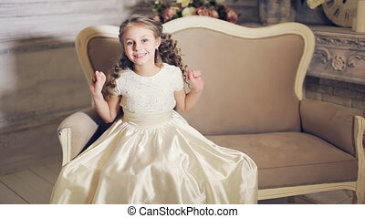 little girl poses for the camera