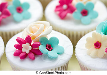 Wedding cupcakes decorated in fuchsia and turquoise