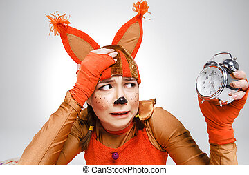 Young woman in the image of red squirrel with horror looking...