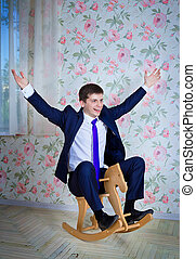 Childish businessman - Happy childish young man in business...