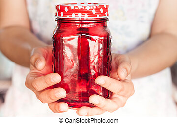 Woman's hand holding red glass, stock photo