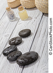 stones for oriental spa massage therapy on wooden background