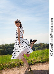 Portrait of a Pin up Girl on a path - Portrait of a...