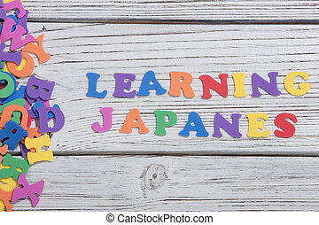 the colorful words japanes made with colorful letters over...