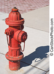 Fire Hydrant - Red Fire Hydrant on a City Sidewalk