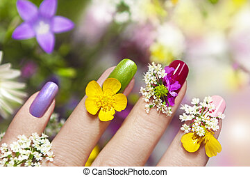 Manicure with natural field. - Multicolored manicure with...