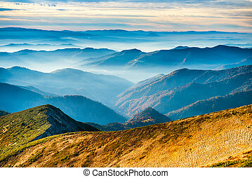 Lanscape with blue mountains and yellow hills