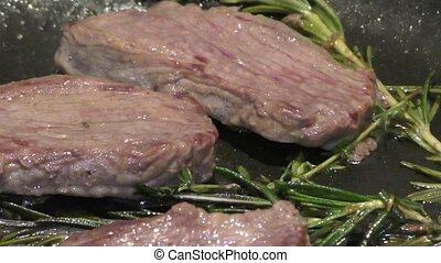Cooking roast beef - Cooking fried beef with Rosemary