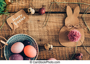 Happy Ester Top view of colored Easter eggs and Easter...