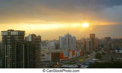 Timelapse of Dramatic scenery sunset of the city center at...