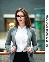 Confident young business woman indoors looking at camera