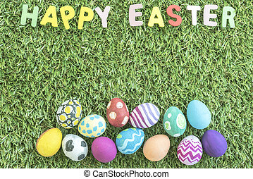 colorful easter eggs on grass background - colorful easter...
