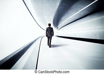 Walk towards the future - Businessman walks in a futuristic...