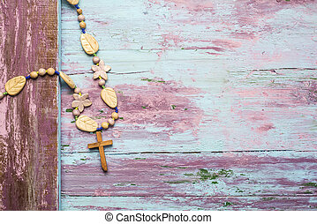 Crucifix wooden background - Crucifix and flower necklace...