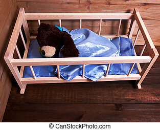 Sleeping teddy bear - Cute teddy bear sleeping in wooden bed...
