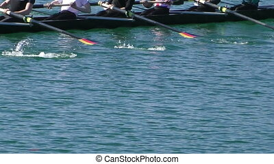 Rowing - Rowers in eight-oar rowing boats, slow motion full...