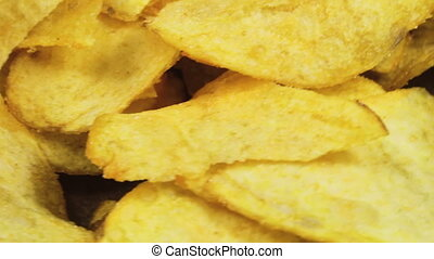 Potato Chips Rotating - Potato chips are on the table and...