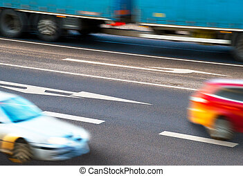Cars going along the crossroads - Three cars going along the...