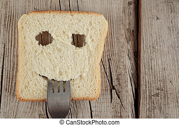 Happy toast with a fork in her mouth on a board