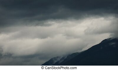 Huge Clouds Moving Over Mountains - Ominous cloudscape with...