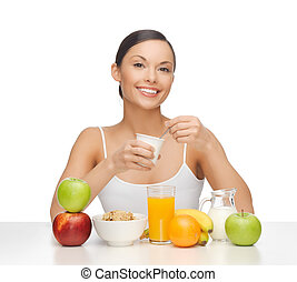 young woman eating healthy breakfast - picture of young...