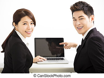 Happy business man and woman showing laptop