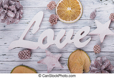 Wood love sign and dried fruit