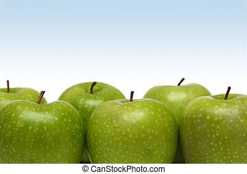 green apples - few green apples on gradient blue background