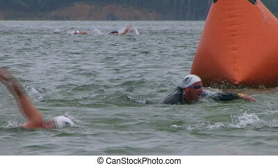 Swimmers Racing In Triathlon 05 - Swimmers racing in...