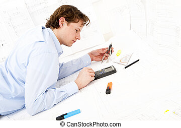 Calculating - Industrial design engineer calculating...