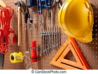 Peg board with tools and hard hat - Peg board with hardhat,...