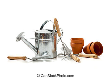 Assorted gardening supplies on a white background - Assorted...