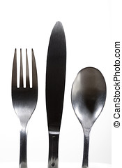 Silverware against white. - Silverware including spoon,...