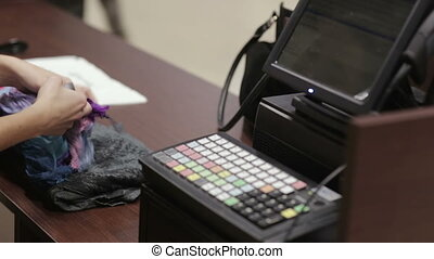 Cash register in the clothing store Employees and buyers