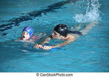 swimming lesson - Close up of swimming lesson - child...