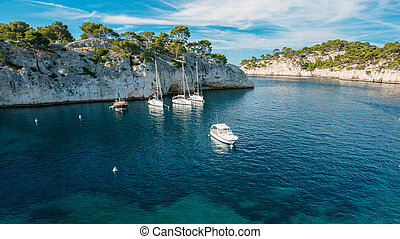 White Yachts boats in bay Calanques in the azure coast of...