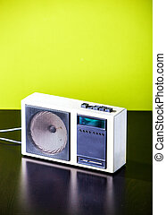 Old retro radio on table with green background - Old retro...