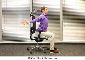 man exercising on chair in office, healthy lifestyle -...