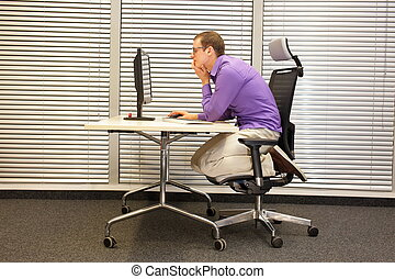 text neck - man in slouching position kneeling on ergonomic...