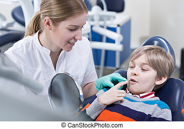 It doesnt hurt anymore - Dentist and her patient after a...