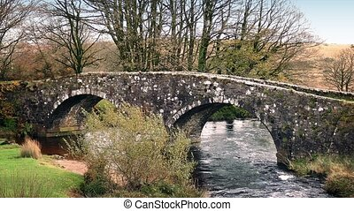 Old Stone Bridge Over River - Double arched historic bridge...