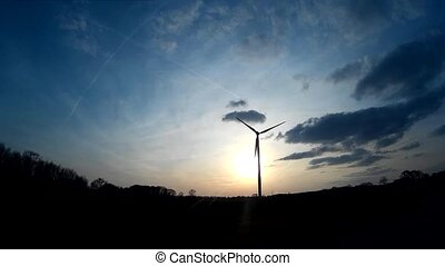 Windturbine / Wind Power with a blue sky and sunrise