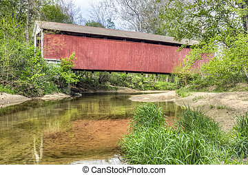 Melcher Covered Bridge Reflection - Built in 1896, Melcher...